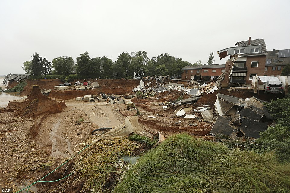 Officials said the landslide in Blessem had 'certainly' killed people though were unable to immediately say how many amid chaos caused by Germany's deadliest flooding crisis for decades
