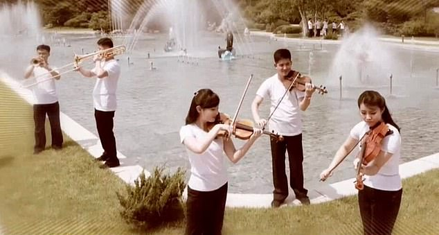 The North Korean dictator is said to be a fan of the Band of the State Affairs Commission (SAC) and their propaganda-laden music which promotes faith in the ruling party. Pictured: The band appears to be playing outside thePaekhwawon Guesthouse in one music video