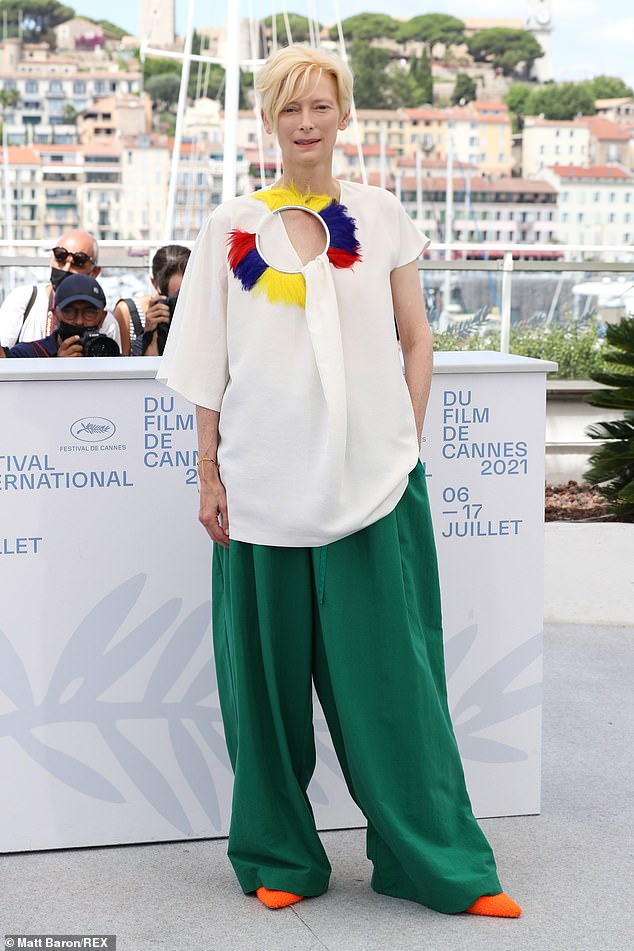 Stunning: Tilda Swinton showed off her quirky sense of style in a colourful blouse and green trousers as she posed for the Memoria photocall at Cannes Film Festival on Friday