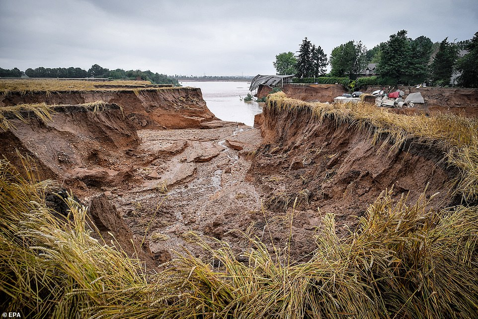 Collapsed ground is seen near the village of Blessem, Germany, after flooding caused a landslide which killed 'several' people