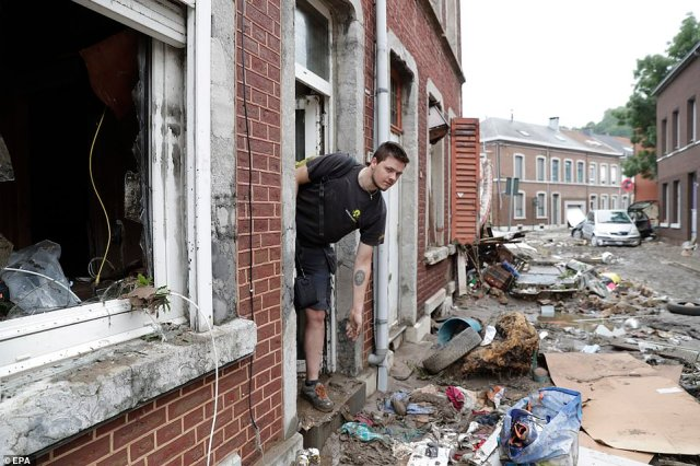 Residents clean up houses after heavy rains had caused severe flooding in Ensival, Verviers, Belgium