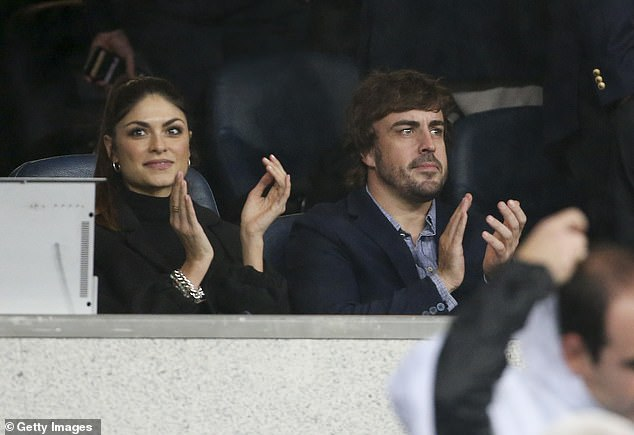 Linda was by her Spanish boyfriend's bedside earlier this year when Fernando was injured in a traffic collision, keeping his family updated on his progress (pictured together in Madrid in 2019)