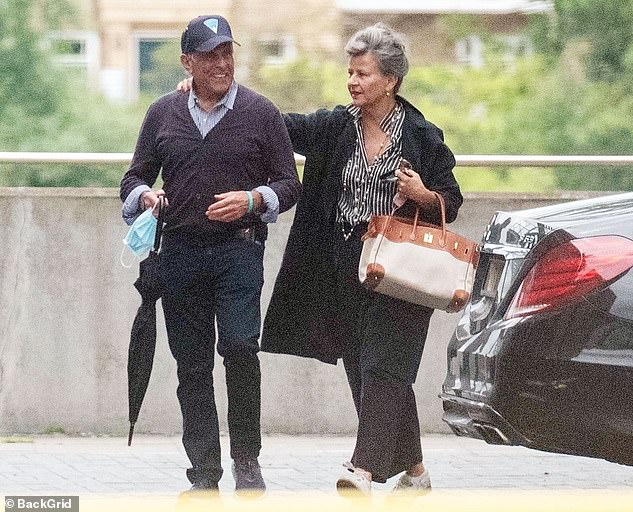 Beautiful: The comedienne looked sensational as she walked arm in arm with the man on their way to enjoy a meal by the river in London
