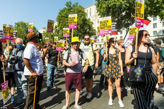 Demonstrators from Stand Up To Racism take part in the protest in London this afternoon