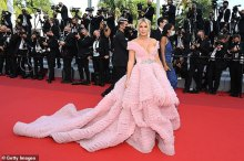 Hofit Golan shows ample bosom in beautiful pink fairy story robe at Cannes Film Festival