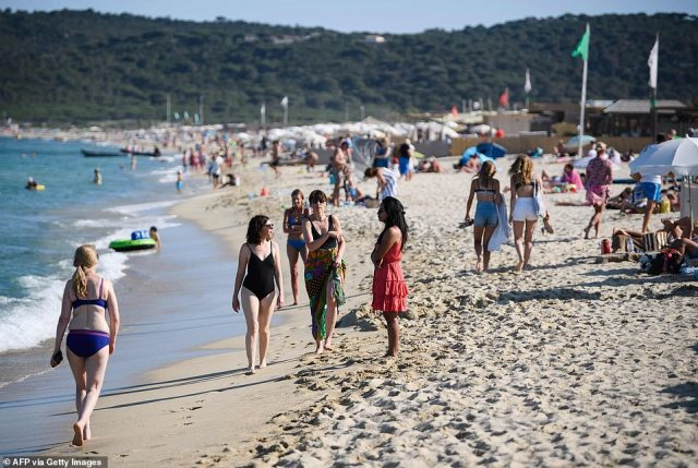 British holidaymakers were dealt yet another blow tonight after the Government announced travellers arriving from France will still have to quarantine - even if they have had both Covid jabs. Pictured, holidaymakers on Pampelonne beach in Saint Tropez, France