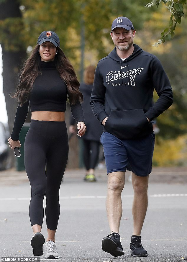 Former Collingwood Nathan Buckley (pictured recently with girlfriend Alex Pike) copped a barrage of online backlash on Sunday