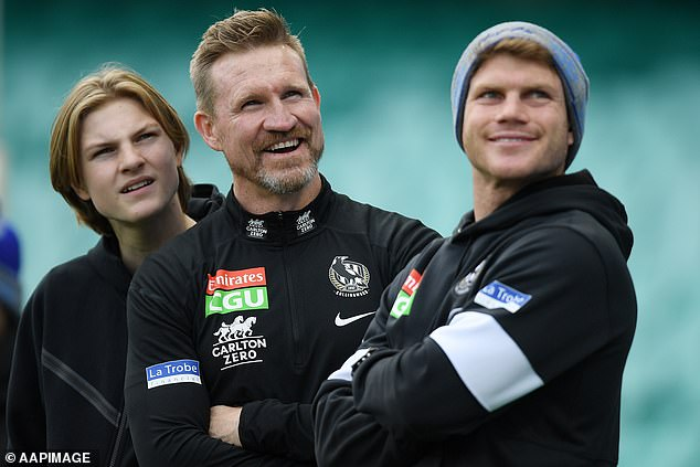 Nathan Buckley (pictured with his sons at his last Collingwood game as coach) ended the heated debate by urging everyone to be kind to one another