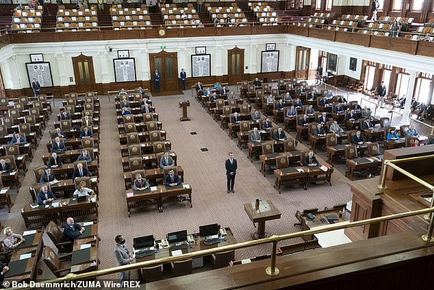Phelan is pictured on Wednesday in the half-empty chamber in Austin, Texas
