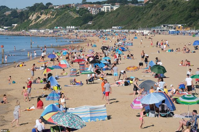 Hundreds of sun seekers arrive to Bournemouth beach today as the country prepares to bask in temperatures of up 91F on what is expected to be the hottest day of the year