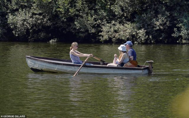 People row along the river in Richmond today on the hottest day of the year so far
