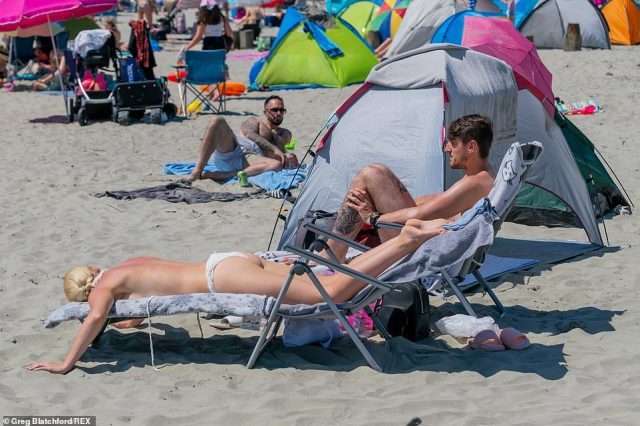On a blazing hot Sunday West Wittering beach, West Sussex, is packed with thousands of people