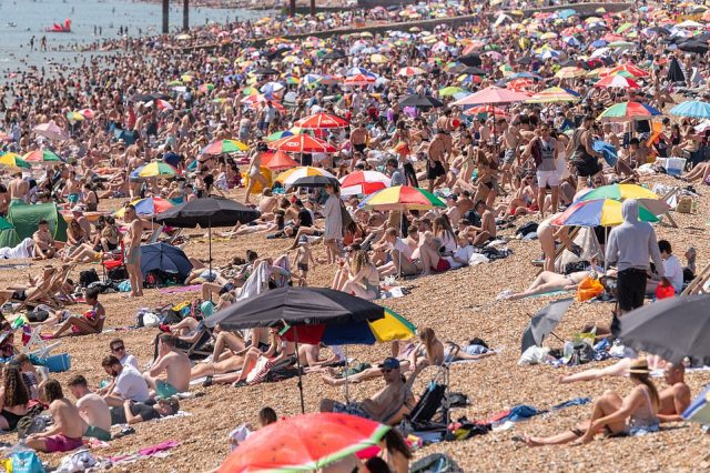 Hundreds of beachgoers packed on to the sea front in Brighton today on the hottest day of the year
