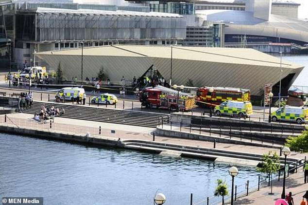 A large cordon was set up at Salford Quays Sunday as crews worked to rescue the teen