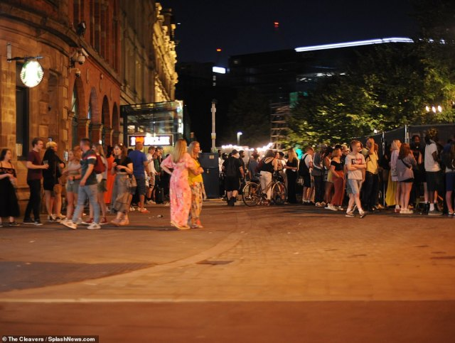 Revellers enjoy a night out in Manchester last night on one of the hottest days of the year as hundreds across the nation enjoy a mini heatwave