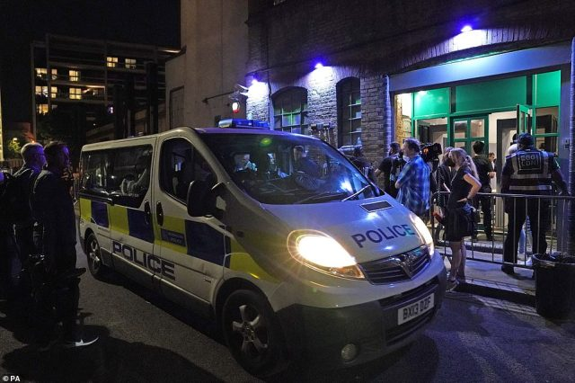 Pictured: Police van outside the Egg nightclub in London as officers spoke to security after the final legal coronavirus restrictions were lifted in England at midnight
