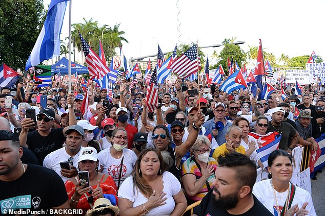 Thousands of Cuban Americans in Miami have taken to the streets in the past week to show solidarity with the island. Pictured: Protesters at the Rally For Democracy in Miami on Sunday