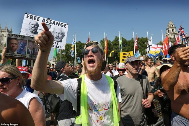 Protesters confront a police line and shout towards the Houses of Parliament this afternoon