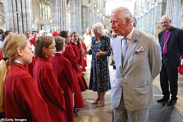 Prince Charles and his wife Camilla with their faces on full display as they mingle with members of the public inside Exeter Cathedral today