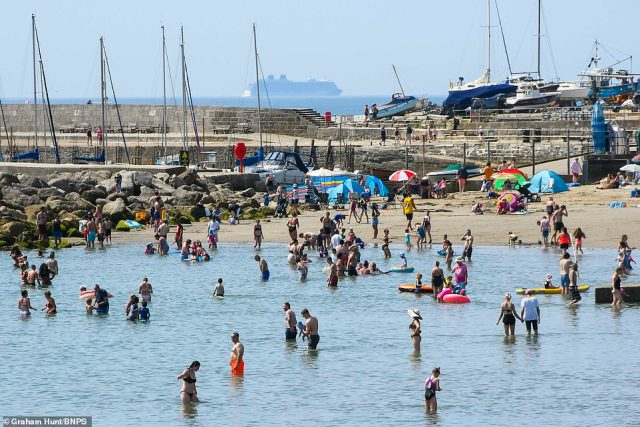 Hordes of people flocked to Lyme Regis in Dorset to enjoy the good weather and seaside