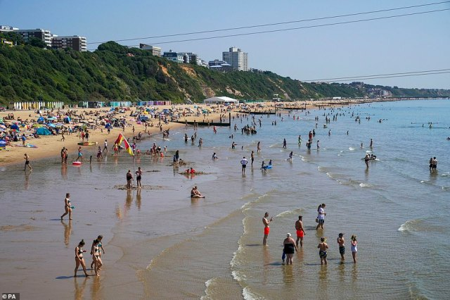 Sunlovers have flocked to the beach in Bournemouth to celebrate the sunny weather in Dorset