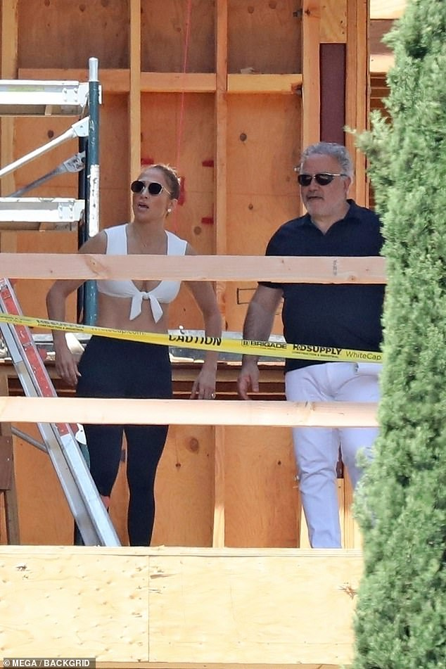 Home sweet home: The 51-year-old entertainer flashed her incredible abs in a white sports bra and leggings while touring the unfinished abode on her quest for a new love nest with on-again boyfriend Ben Affleck