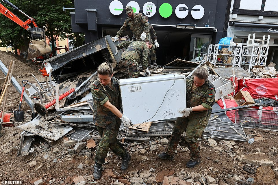 Members of the Bundeswehr work in an area affected by floods caused by heavy rainfalls in Bad Muenstereifel, Germany