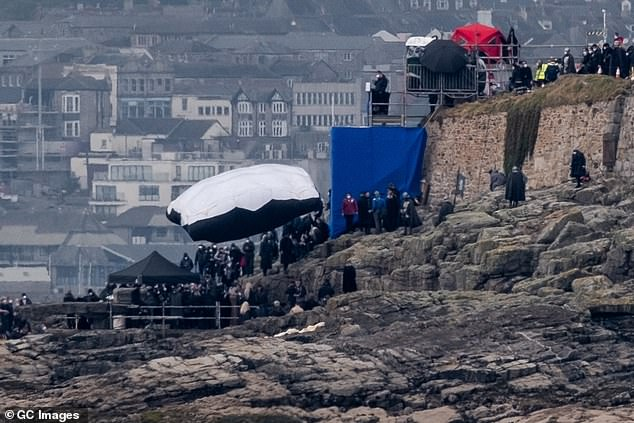 Off work: It is understood that the UK shoot has been shut down for two days and the team are hoping to resume production on Wednesday (pictured, the shoot in Cornwall in April)