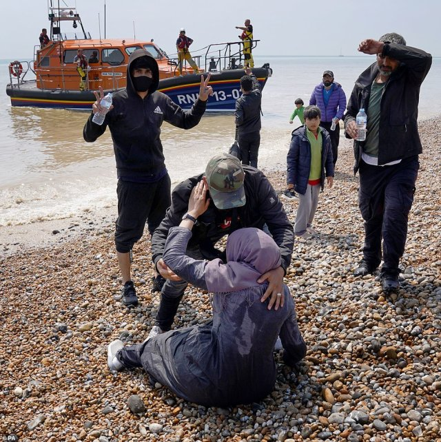 Dozens of people, including women and young children, were seen arriving at Dungeness