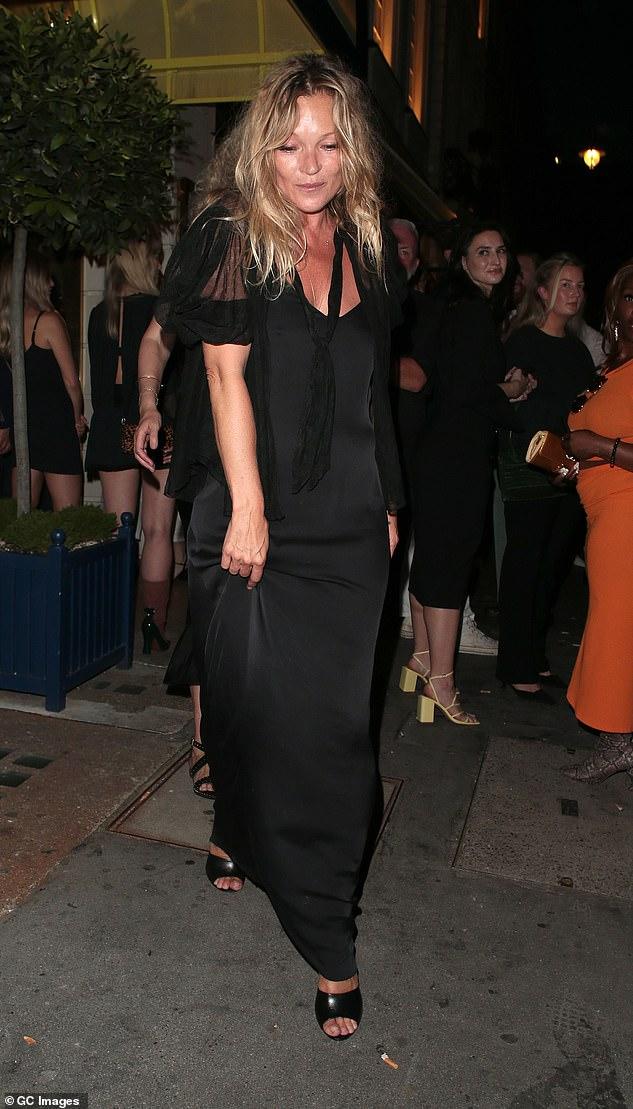 Looking good: Kate's black slip dress highlighted her incredible figure