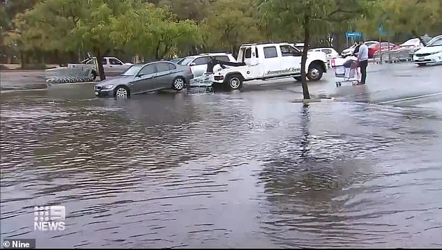 Perth has smashed its 20-year rain record for July with more wet weather on the way while Australia's south-east is set to shiver through hazardous wind conditions over the coming days (pictured flooding in Perth earlier this month)