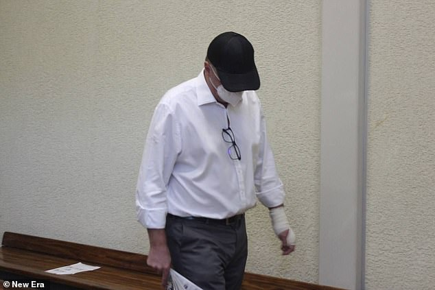 Boulter, 51, leaves Windhoek High Court, Namibia, after being given bail for alleged murder