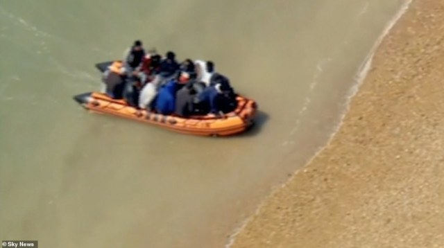 Sky News showed aerial shots of the men who were seen getting out and sitting on the pebble beach while some washed their feet in the water as a rubber ring brought as a makeshift safety aid floated up shore