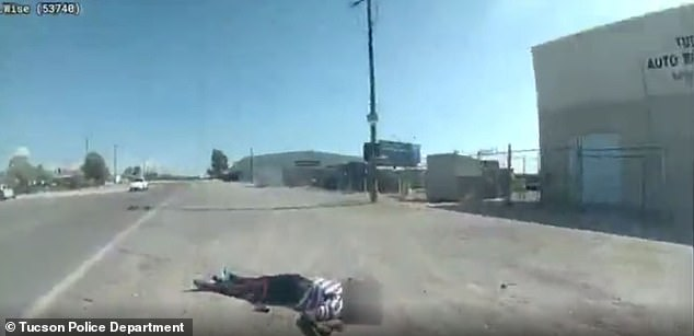Scarlett is seen bleeding in the middle of the road after the officer-involved shooting