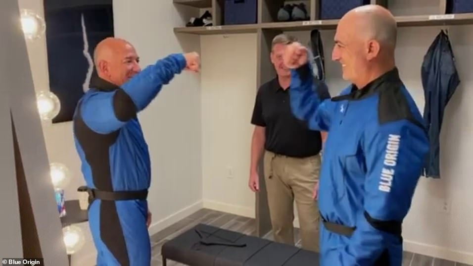 Jeff Bezos is seen giving a fist bump to his brother Mark in Monday's Instagram post. The brothers will fly into space together on Tuesday, all being well