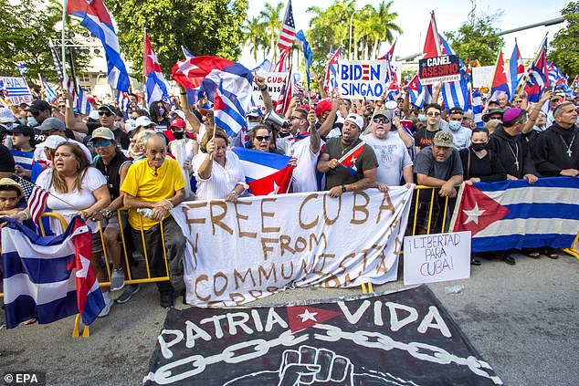 Cuban-Americans participate in a demonstration to show support for protesters in Cuba, in front of the Freedom Tower in Miami on Saturday