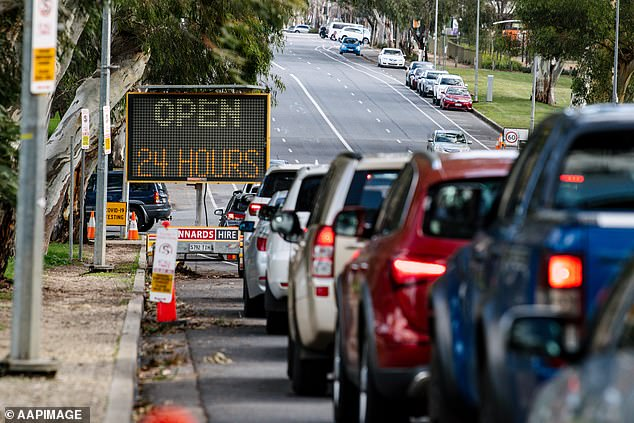 South Australia has also entered a seven day lockdown after a total of five infections were recorded (pictured, testing in Adelaide on Tuesday)