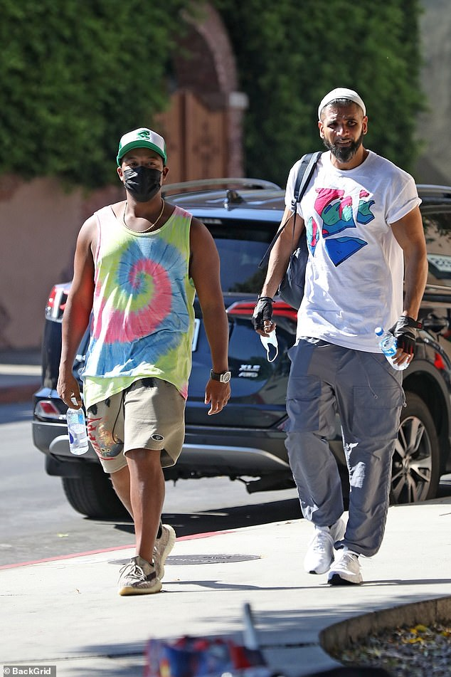 Workout: The 29-year-old actor — who found fame on That's so Raven and Cory in the House — sported a colorful tie-dye tank top and shorts for a fitness session with a friend