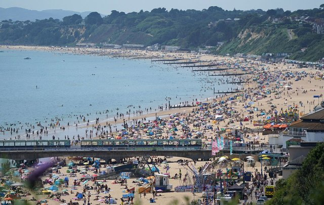 People enjoying the hot weather at Bournemouth Beach in Dorset on yet another scorching hot afternoon across the UK
