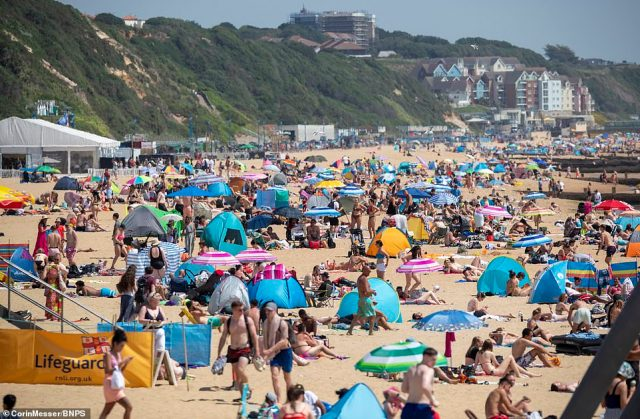 Thousands flock to the beaches of Bournemouth in Dorset to cool off amid more soaring temperatures across the UK