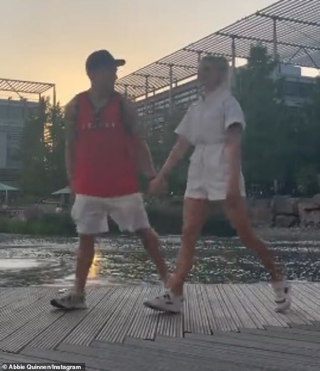 Matching up:Abbie was coordinated with AJ as her cute playsuit matched the colour of his shorts in the video