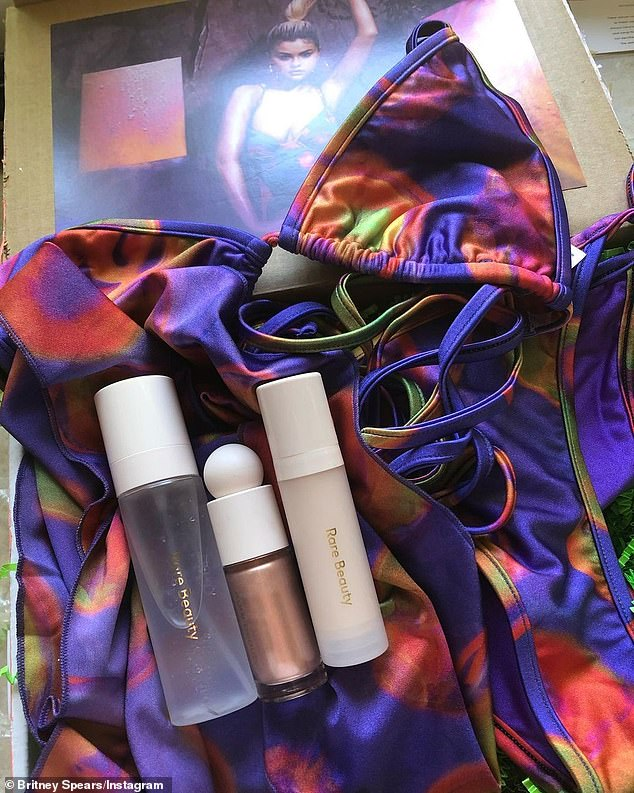So many goodies: The box contained a tie-dye bikini and her three 'favorite makeup products' from Selena's Weird beauty range