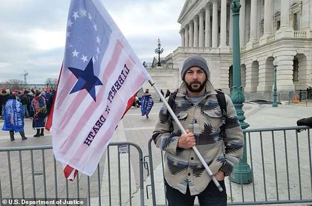 Special agent with the Drug Enforcement Administration Mark Sami Ibrahim has been arrested for taking part in the Capitol riot with his firearm and while waving a flag reading 'Liberty or Death