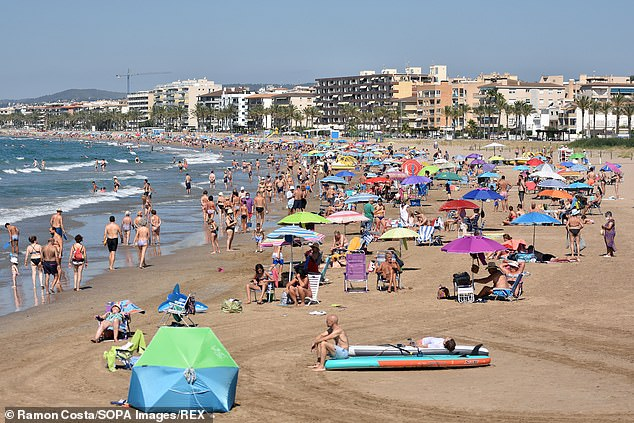 Spain is unlikely to be added to the 'amber-plus' list imminently – despite data showing higher Beta variant rates there than in France, ministers insisted last night. Pictured: People enjoy the sun and the warm weather at the Playa Segur de Calafell Beach in Calafell