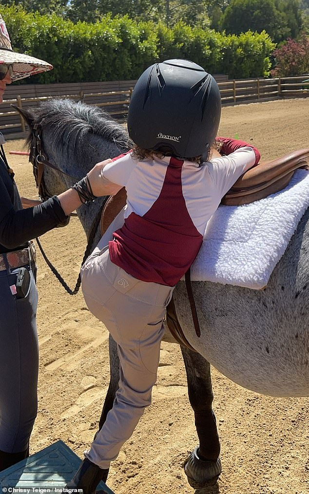 Family outing:Another photos showed her daughter Luna climbing atop a smaller pony with some assistance
