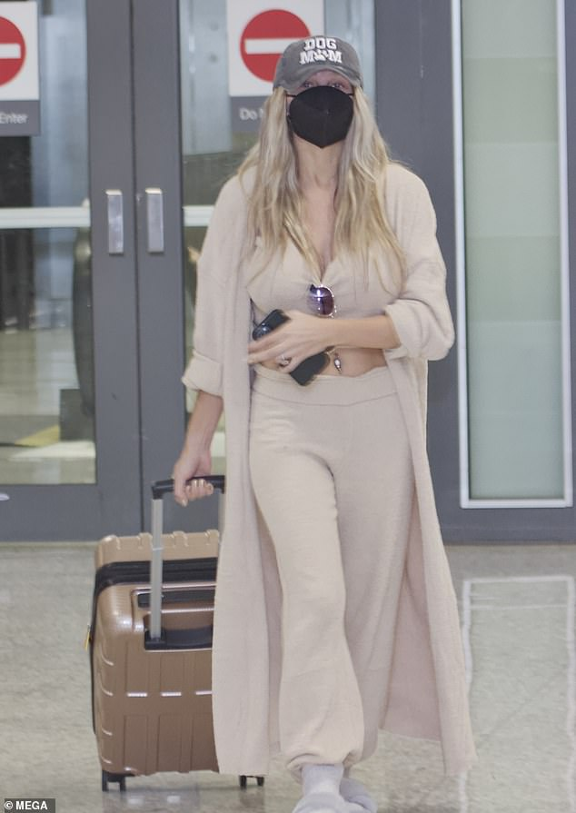 Cross-country trip: Courtney Stodden, 26, looked comfortable in revealing sweats as they arrived at an airport near Washington, DC, with fiancé Chris Sheng on Tuesday for a PETA protest