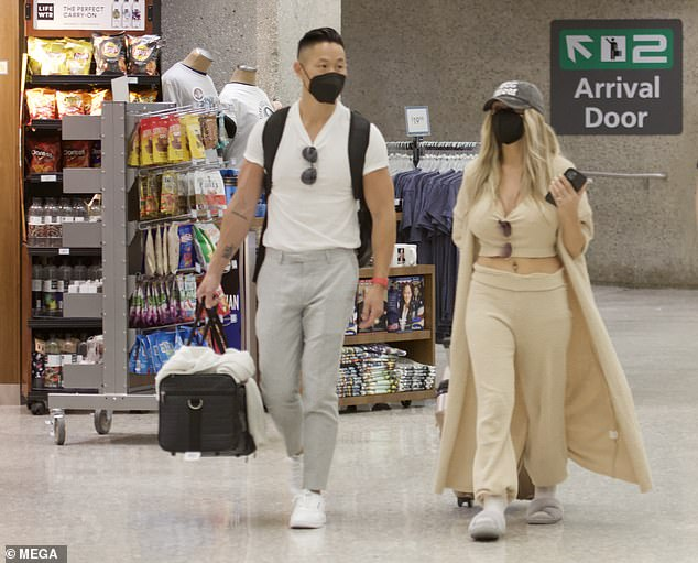 Cozy: Courtney showed off their toned tummy in a beige crop top and matching sweatpants, plus a long cardigan