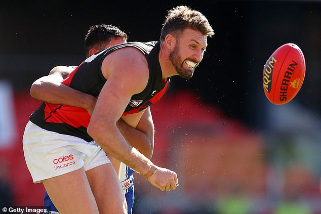 Essendon coach Ben Rutten says Cale Hooker (pictured) is no certainty to be at the AFL club next year despite the versatile veteran leading the Bombers' goal-kicking this season