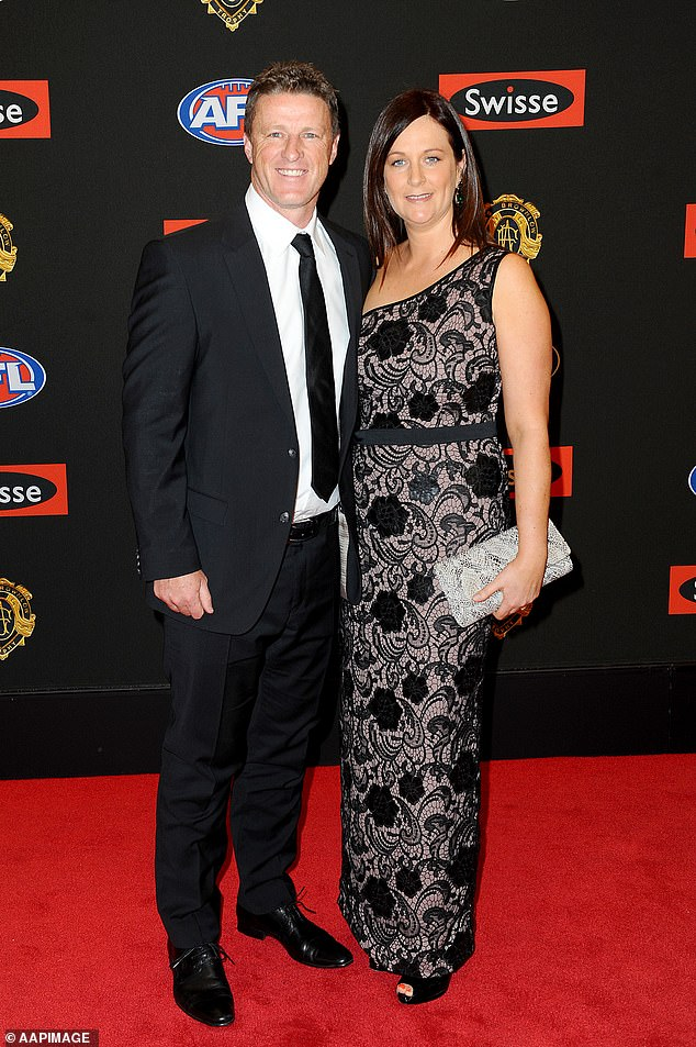 Moving forward: Danielle Hardwick has launched a new initiative to help Indigenous artists after splitting with her husband of 30 years Damien Hardwick. Pictured together at the Brownlow Medal awards in 2014