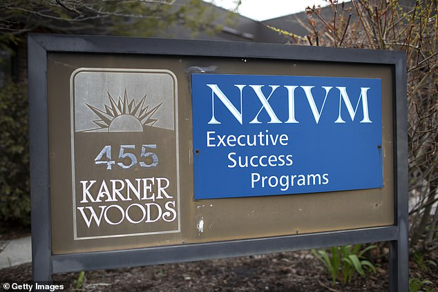A sign outside the now-defunct NXIVM headquarters is seen in Albany, New York